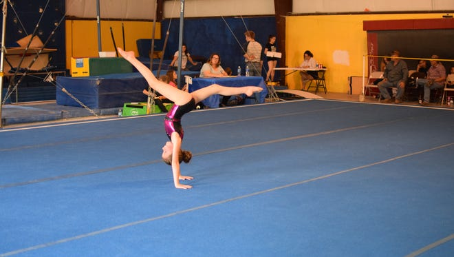 Eight-year-old Emma Bellon of Ruidoso Gymnastics Association performs at a recent competition. The gym plans a sleepover camp June 24-25 for current or aspiring gymnasts.