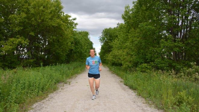 Melissa Dupke, a board member of the Friends of the Ahnapee State Trail, practices for the Summer Solstice 50 relay run on June 18.