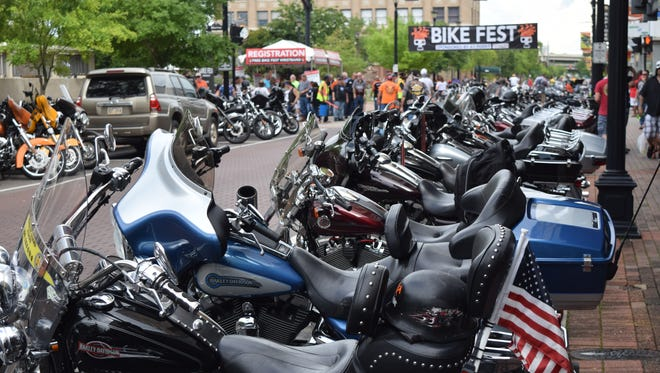Motorcycles line Third Street in downtown Alexandria for the Alexandria Bike Festival held Saturday. Events included motorcycle performances, music and fireworks. Also included was a rumble where motorcycles cranked their engines to a deafening roar.