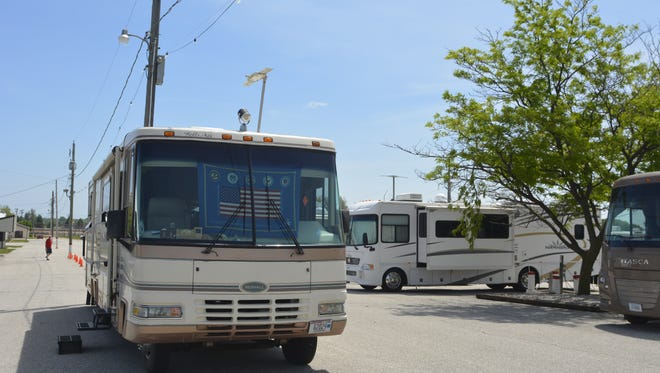 An RV is set up on the grounds of the Manitowoc County Expo for an RV rally by the Wisconsin Badgers chapter of the Family Motor Coach Association.