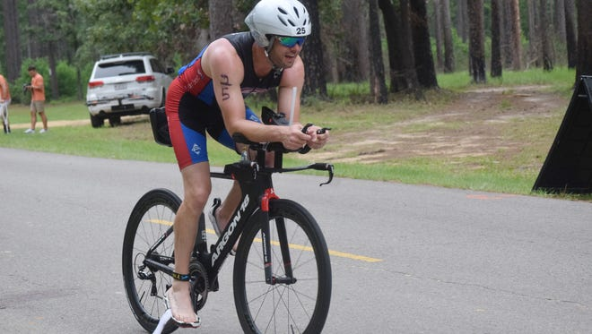 Wesley Watkins of Alexandria rides in the 20-mile bike portion of the 2016 Indian Creek Triathlon held Saturday at the Indian Creek Recreation Area in Woodworth.