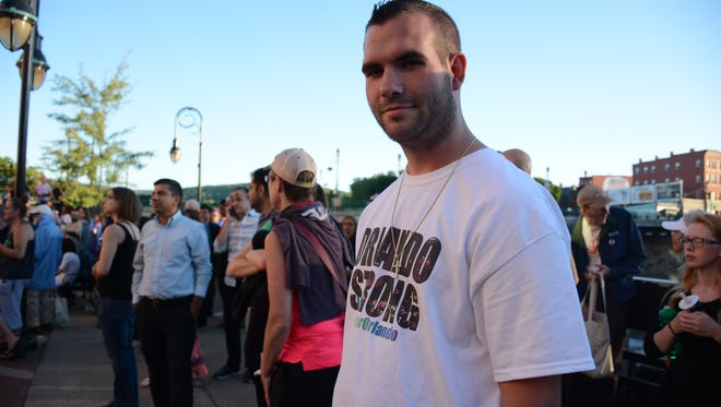 Shane Fish, a Binghamton native who moved back from Orlando shortly before the shooting, was one of about 500 who attended a vigil in Binghamton Tuesday evening to honor the 49 who lost their lives at the Orlando gay nightclub Pulse early Sunday. Fish said he lost several friends in the gunfire.