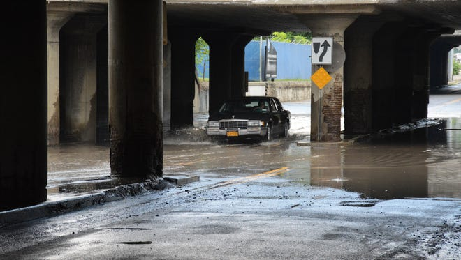 A car braves high water Tuesday while going through the Brandywine Avenue underpass in Binghamton.