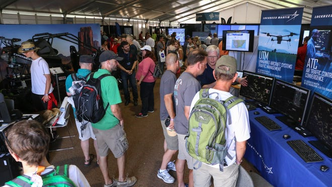 Visitors learn about aviation careers at AirVenture 2015.