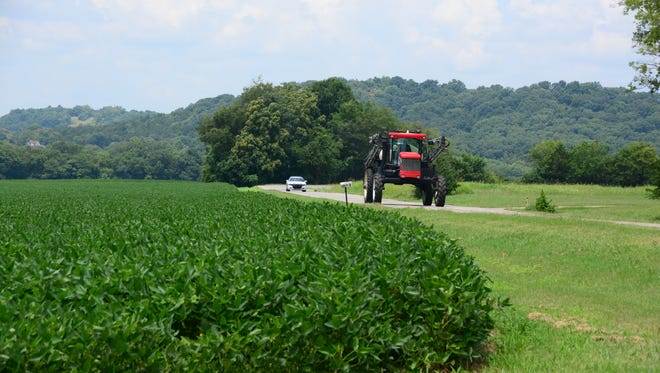 A tractor drives along Coleman Road in Franklin, Tenn.