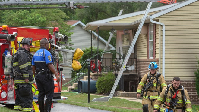 Fire fighters clean up after dousing a fire in a York Township apartment. Sunday, July 31, 2016. John A. Pavoncello photo