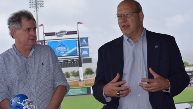 UWF athletic director Dave Scott (right) discusses new television arrangement as Blab-TV CEO Doug Bunze listens during Friday's announcement at Blue Wahoos Stadium.