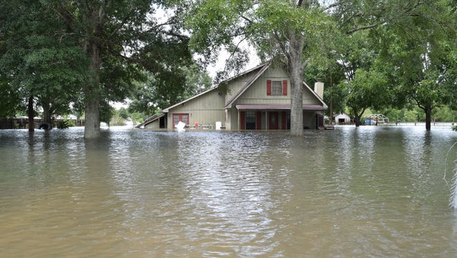 The UL football team will help to clean out flooded homes on Tuesday afternoon.