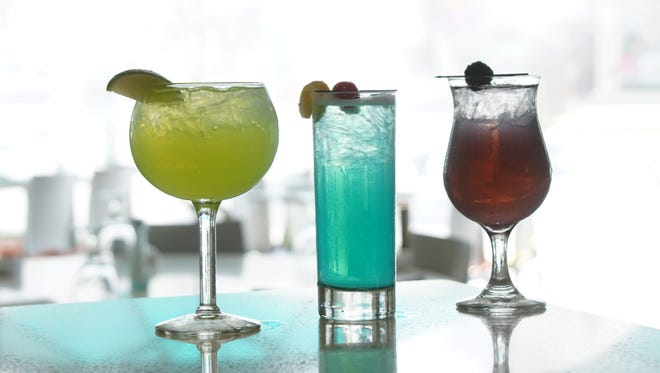 From left to right, The Hulk Margarita, Superman and The Dark Knight cocktails from Lulu California Bistro.