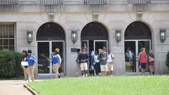 Students leave Bolton High School as the final bell rings ending the school day.