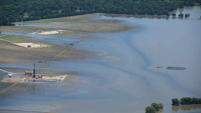 An oil spill on the Lower Trinity River was photographed in June 2015 by the Texas Civil Air Patrol. Any spill is a violation of Texas Railroad Commission rules, but the Texas Sunset Advisory Commission accuses the agency of lax enforcement.