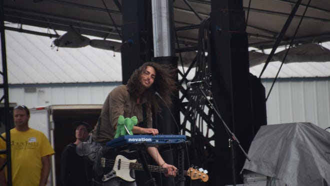 Corey Horn from Remedy Drive takes moment away from bass to play some keyboards on Saturday at Lifelight.