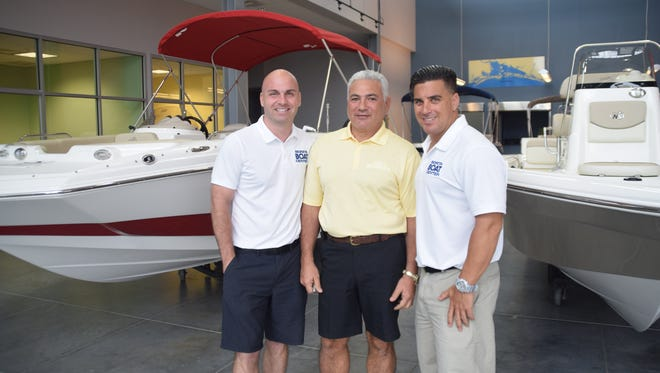 John Gagliano, center, is the new owner of Bonita Boat Center. It continues to be a family business as he works with his son, Jon Gagliano, right, and son-in-law, Joe Martin, left.