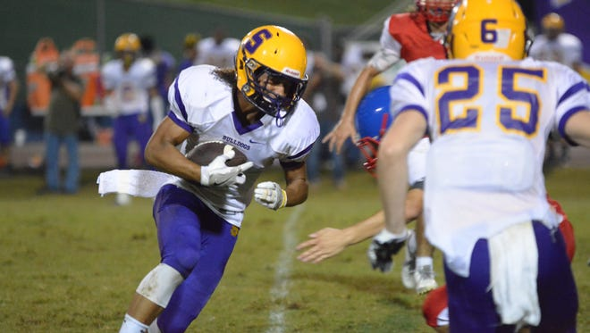 Smyrna's Blake Watkins looks for running room during Friday's win at Warren County.