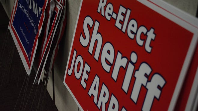 Yard signs for Maricopa County Sheriff Joe Arpaio and Republican presidential candidate Donald Trump to be given away at a meeting of the Surprise Tea Party in Surprise, Arizona on September 20, 2016.