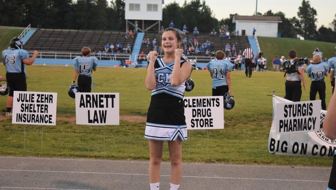 Kaitlyn King cheering for the UCMS Indians.