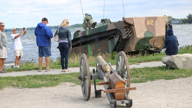 Visitors at the Port Clinton Homecoming Festival check out a 1945 LVT-4 Water Buffalo, a historic amphibious military vehicle, which was offering rides on Saturday.
