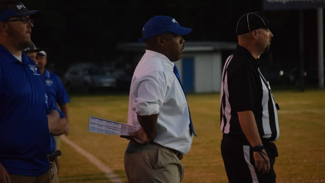 Bolton coach Mark Teague (center) looks on during the 2016 Squirrel Bowl Game vs. Buckeye.
