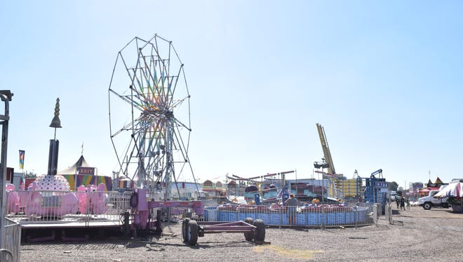 Workers with the Mighty Thomas Carnival set up rides Tuesday at the Rapides Parish Fairgrounds located on Highway 71 South near LSUA.