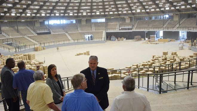The main arena of the Rapides Parish Coliseum can be seen during this visit last week by Louisiana High School Athletic Association Executive Director Eddie Bonine (dark suit, center), police jurors and others. The Coliseum renovation project is about 90 percent complete.
