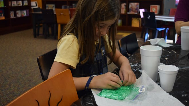 Macy Gough works to make her slime.