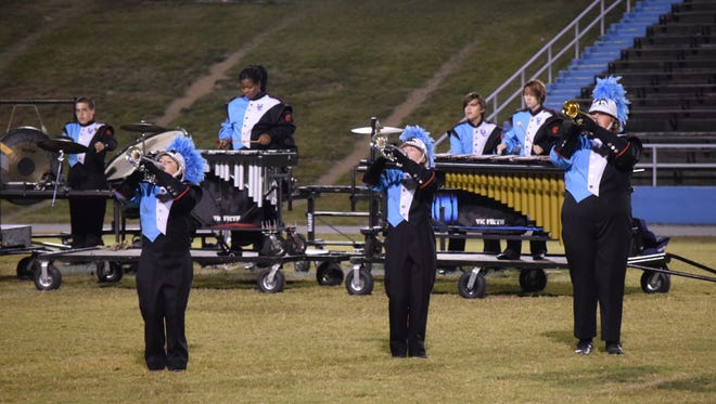 Members of the B.o.B stand with precision during the showcase. This year, there are 32 students involved in Marching Band.
