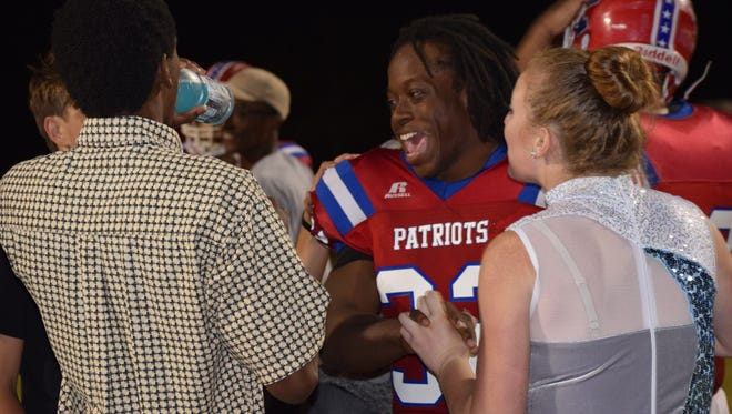 Pace High running back Anthony Johnson is mobbed by students after he ended his high school career as school's all-time leading rusher and record setting in three categories. .
