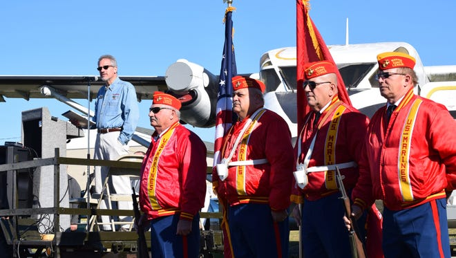 Robert Trivellini, vice president of the Millville Army Air Field Museum Board of Directors, welcomes the crowd as Semper Marine Detachment 205 of Vineland posts the colors during the 15th annual Veterans Appreciation Day ceremony. Photo/Jodi Streahle