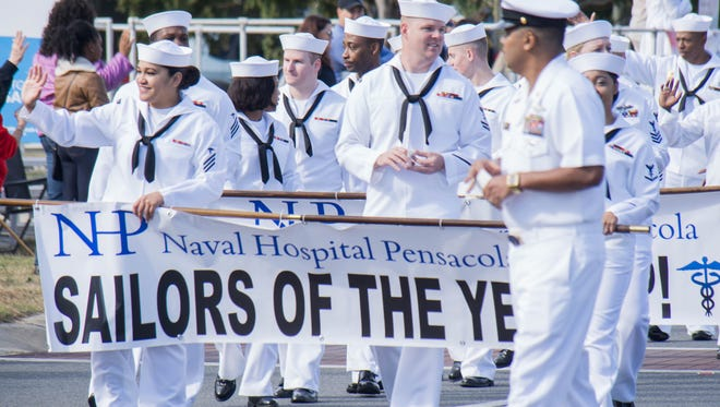 Participants in last year's Pensacola Veterans Day Parade travel down Bayfront Friday toward Veterans Memorial Park. This year's parade gets underway at 9 a.m. Saturday.