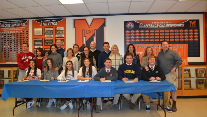 Family and faculty joined seven Mountain Lakes High School students on Nov. 9 as they signed letters of intent to play at the college level.