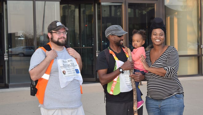 Eric Koestel, Terrell Gerton, Terrell's daughter Nolana and Terrell's fiance, Ebony Jordan standing at the front of the Freedom Center in Cincinnati after Terrell and Eric finished the final day of a 116 mile walk on November 7, from Louisville to Cincinnati in honor of Henry Bibb.
