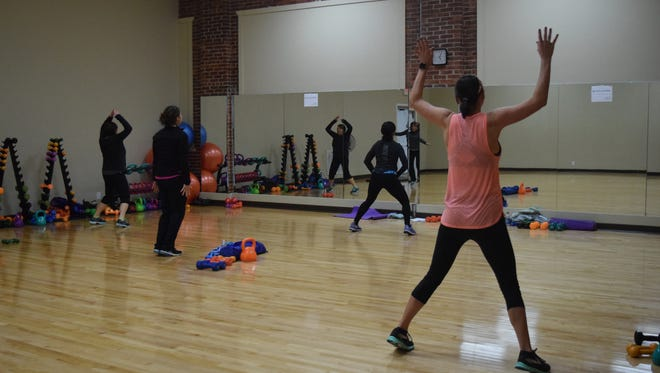 Several members enjoy a cardio tabata class during the open house. Several classes were open to try out during the open house.