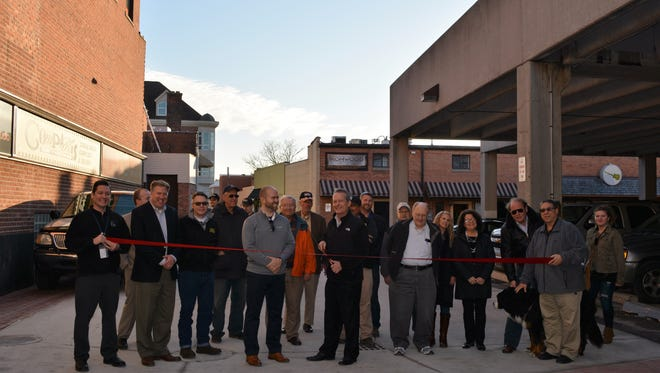 Officials celebrate the end of a $1 million project on Fleet Street.
