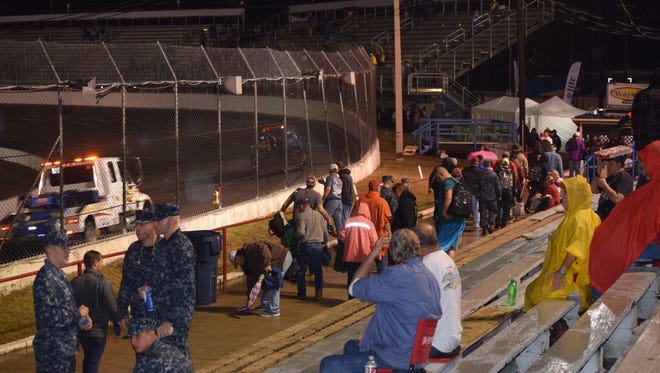 Only the hearty diehard fans were left when more rain fell around 6 p.m. Sunday, forcing postponement of the 49th Snowball Derby until Monday.