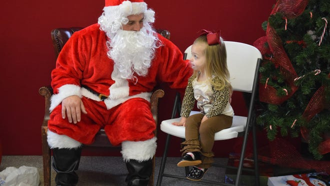 Sawyer Logan shares with Santa her Christmas wishes.