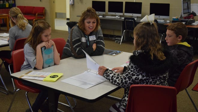 Melissa Willett hears from Adrina George, Karley Byrd and Jonathan Hargrove during Leadership Day.