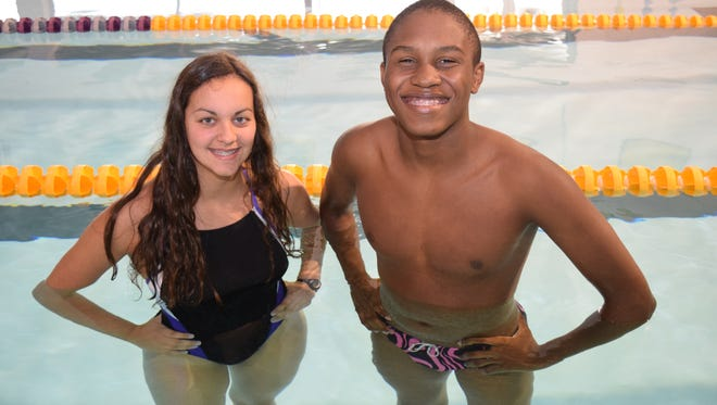 ASH's Brianna Serret (left) and Daniel Lewis helped the Trojans get off to a strong start to the season at the St. Aloysius Invitational in Vicksburg, Miss.