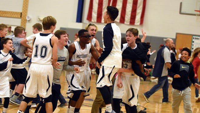 Knox Doss Middle at Drakes Creek players celebrate after defeating Hunter 47-44 on Tuesday evening.
