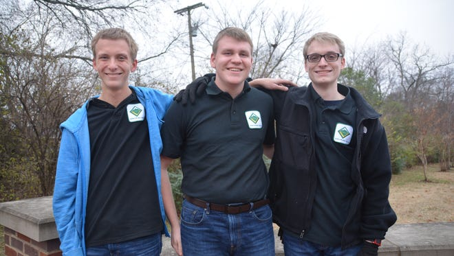 Phil Barrett, left, Chris Barrett and Andy Barrett, triplets, earned the Eagle Scout Rank in December. It's the highest achievement for the Boy Scouts of America.