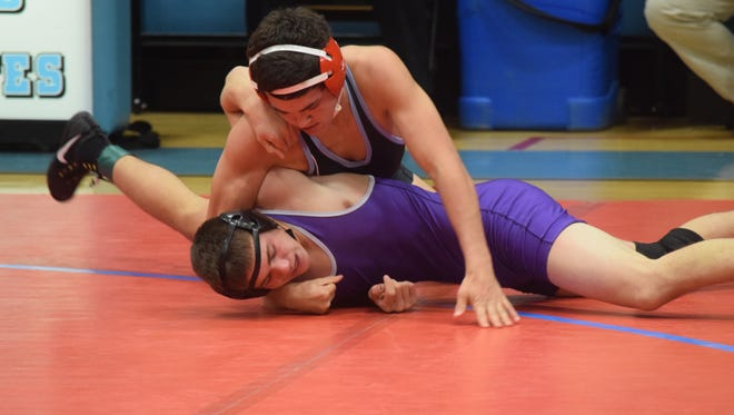 Saul Ervin wrestles his opponent at a previous match earlier in the month. Ervin was one of nine to go undefeated at the Harrison Ten Way championship.