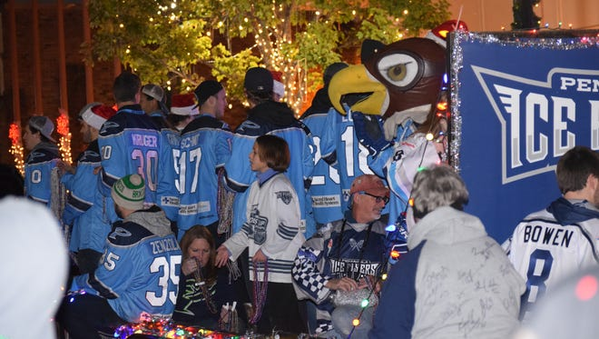 The Ice Flyers were part of the festive scene Dec. 10 at the annual Pensacola Christmas Parade. The team is making the most of Christmas Day by having a team dinner on Pensacola Beach.
