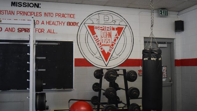 The YMCA logo, showcased in one of the many work out rooms.