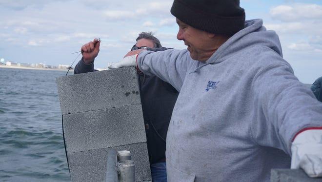 Capt. Monty Hawkins preparing to drop blocks for new reef construction off the coast of Ocean City.