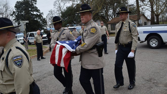 The Rapides Sheriff's Department Honor Guard carries the casket of the late K9 officer Turbo. A memorial service was held for Turbo at the Grant Parish Sheriff's office. Turbo was five and half and was believed to have died from a brain tumor or bleeding on the brain.