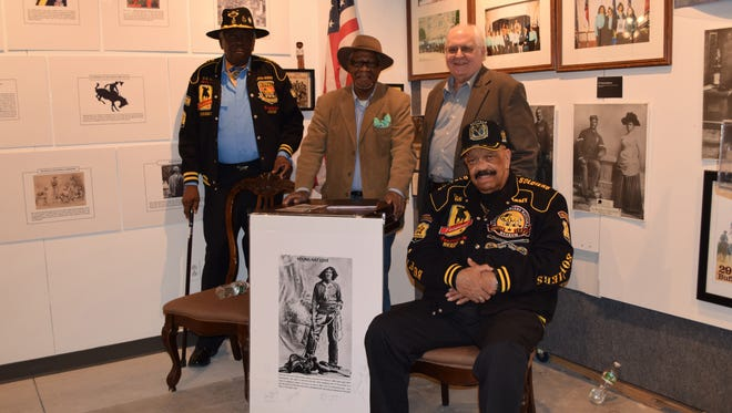 An opening reception was held Friday, Feb. 10 for the Black Cowboys & Buffalo Soldiers exhibit at the African American Heritage Museum of Southern New Jersey Inc. Pictured from left are Commander Peter B. Walker of the Buffalo Soldiers 24th Infantry, Ralph Hunter, museum founder, Kimball Baker, exhibit curator and Lazarus E. Jackson Jr., a member of the Buffalo Soldiers. Photo/Jodi Streahle