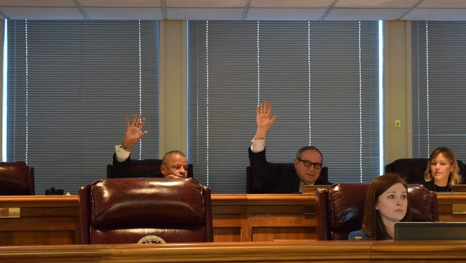 Dels. Luke Torian, D-Prince William,  and Mark D. Sickles, D-Fairfax, raise their hand during a vote Tuesday.  Five Republicans on the Elections Subcommittee voted to kill redistricting proposals. Sickles and Torian  voted to keep the redistricting bills alive.