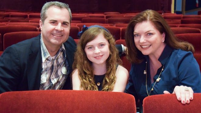 """Ten-year-old Liza Jayne Longenhagen (center) with her parents at Florida Repertory Theatre. Liza stars as Scout in Florida Rep's """"To Kill a Mockingbird."""" It's the same theater where parents Greg Longenhagen and Liz Abbott acted before she was born."""