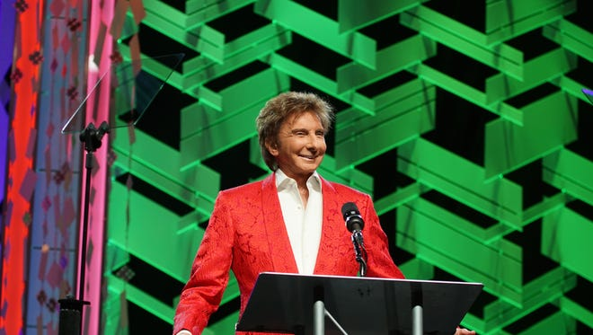 FILE - Barry Manilow honored his friend Elizabeth Taylor.