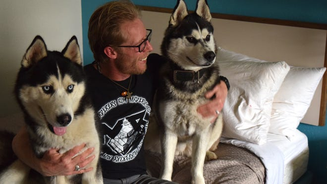 Georgie Cutright with his dogs, Sarah and Lobos, at Cutright's room at the Motel 6 off Merchants Drive in Knoxville.