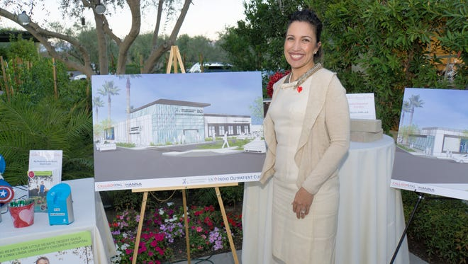 Indio Pavilion project manager Leticia Gasca-Guerrero with a picture of the new Indio building.